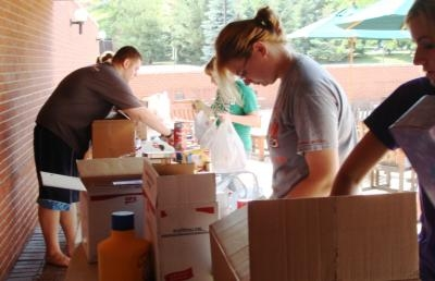 Students pack food for the Ashland County Food Bank at a past AUGIVS event.