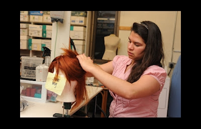 "Brittany Hartman styles wigs for the Ashland University production of ""Marisol"" in the fall of 2010."