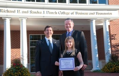Dr. Ray Jacobs (left), associate dean of the Dauch College of Business and Economics, and Dr. Jeff Russell, dean of the Dauch College of Business and Economics, pose with scholarship recipient Hayley Ramser.