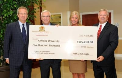 Medical Mutual's Jared Chaney (l) and Rick Chiricosta present a $500,000 check to Ashland University's Margaret Pomfret and President Fred Finks (r).