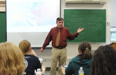 Dr. John Moser, professor of history, teaches a history class at Ashland University.