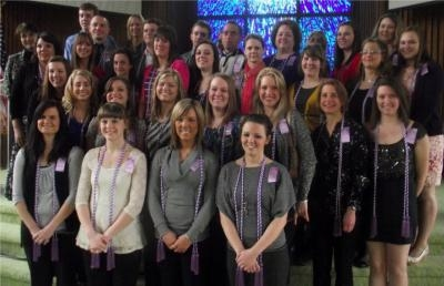 College of Nursing and Health Sciences Dean Faye Grund with Ashland University nursing student inductees.