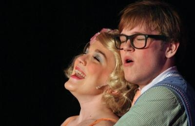 "Katie Mounts and Jacob Poiner in the 2014 spring production of ""Little Shop of Horrors"""